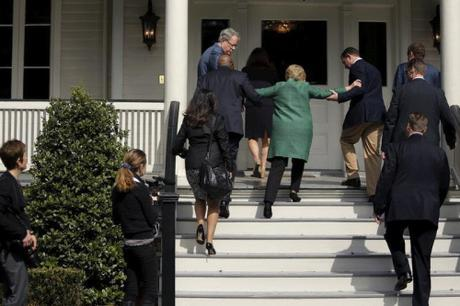 Hillary being helped up stairs 2016