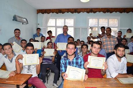 Graduates of the Riyadeh course pose with their professors.