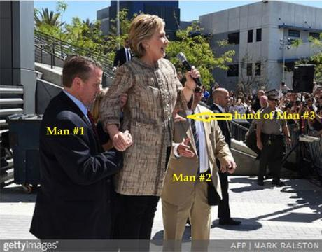 Hillary propped up by man in L.A., April 2016
