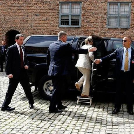 Hillary Clinton needs step to get into car