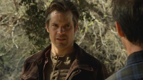 Raylan wears a decidedly different - but similarly-colored - henley by the time