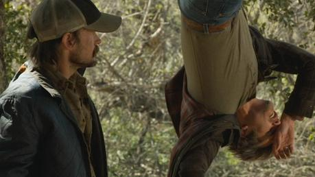 Raylan's belt is best seen as he falls victim to Dickie Bennett's backwoods torture device in