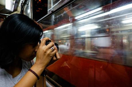 Charlene making magic for her In Transit project on the no. 2 tram