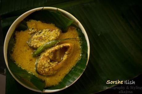 Hilsa fish cooked in mustard sauce(Sorshe Ilish)
