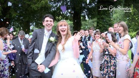 purple wedding confetti outside mitton hall lancashire