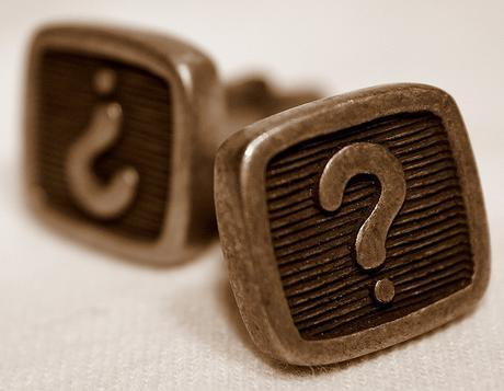 Cufflinks with a question mark on them