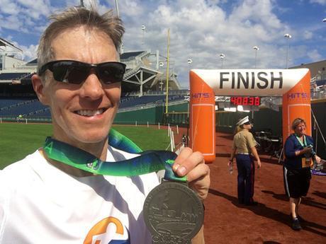 Mike Sohaskey with Omaha Marathon medal