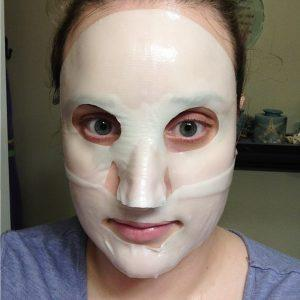 Goodal Premium Snail Tone-Up Hydrogel Mask on face