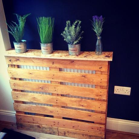 A Herb garden on top of a pallet style homemade radiator cover