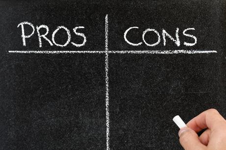 Pros and cons written on a blackboard in chalk
