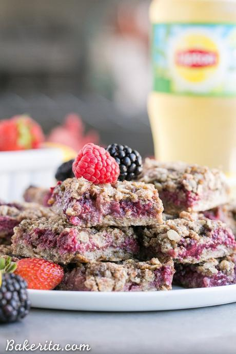 These Lemon Berry Oatmeal Snack Bars are the perfect mid-day treat or dessert to satisfy your hunger! These snack bars have an oatmeal crust, a tangy lemon mixed berry filling, and they're gluten-free + vegan.