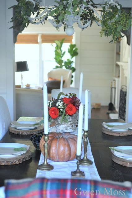 orange roses and seeded eucalyptus and a simple Fall table