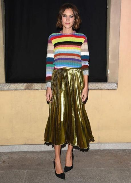 Alexa Chung Pairs A Multicolor Striped Sweater With Pleated Gold Skirt