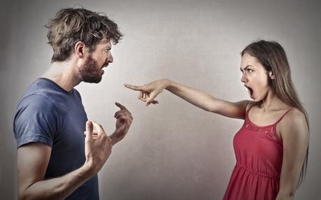 Angry woman pointing at a man