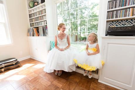 Bride looks at bridesmaid in picture window Tips for children at weddings