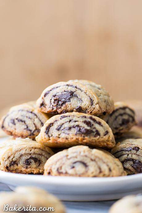 These Chocolate Rugelach are incredibly tender and flaky, thanks to the cream cheese-based dough. These refined sugar-free and gluten-free rugelach are filled with dark chocolate shavings for an irresistible holiday treat.
