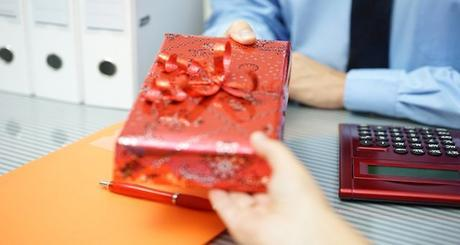 businessman is receiving a gift from partner