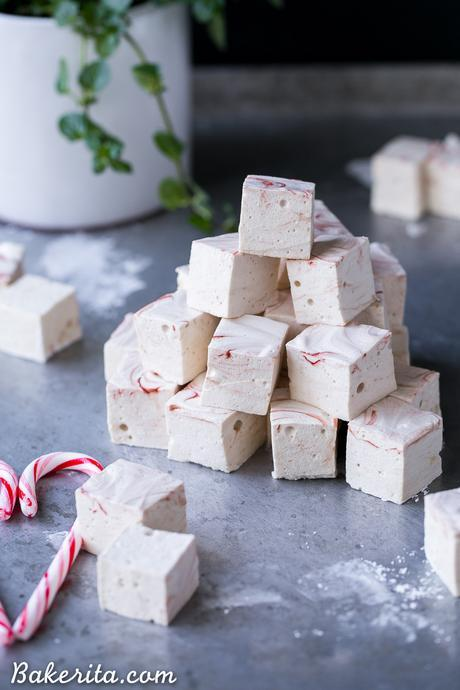 These Paleo Peppermint Marshmallows are exactly what your hot chocolate needs! They're light, fluffy, and easier to make than you'd think. This recipe is Paleo + refined sugar free, with a beautiful swirl of homemade red food coloring!