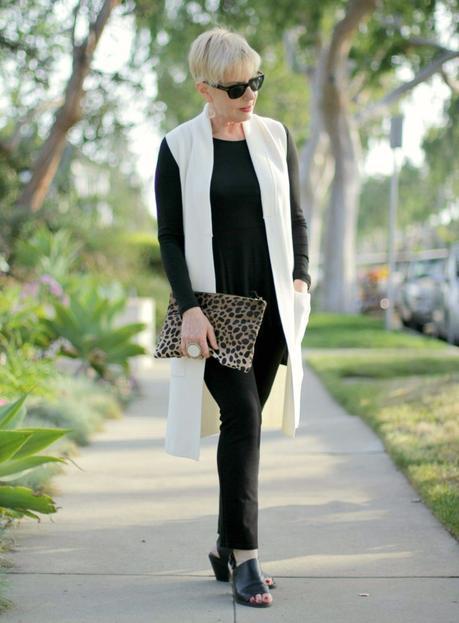 ivory sweater vest over black