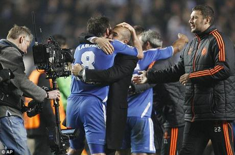 Party time: Chelsea manager Roberto Di Matteo celebrates with Frank Lampard after their win over Napoli