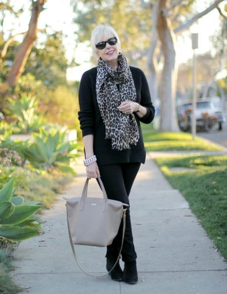 all-black outfit with neutral accessories
