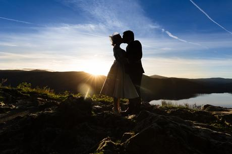 Silhouette of bride and groom kissing in the sunset Derwentwater Independent Hostel Wedding