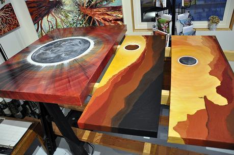 Eclipse paintings on drying rack in Cedar Lee art studio