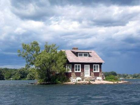 house-4-just-room-enough-island-is-one-of-the-famous-thousand-islands-that-straddle-the-us-canada-border-in-the-saint-lawrence-river-there-are-a-few-lawn-chairs-out-front-on-the-familys-tiny-beach