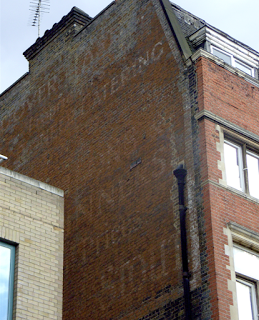 Another visit to Lower Marsh – barrows and arrowsI still think there must be an old painted ad and a lost ghostsign