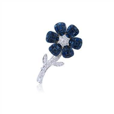 Invisible set princess sapphires in white gold at I.D. Jewelry