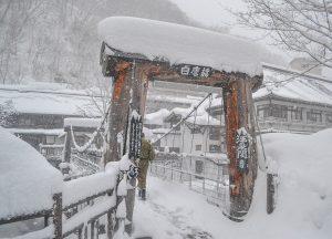 Bridge Crossing, Osenkaku Ryokan Takaragawa Onsen in Winter Snow