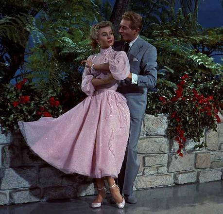 Vera-Ellen-in-her-pink-tea-dress-with-full-circle-skirt---White-Christmas