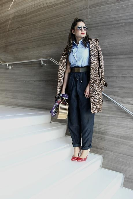 how to stay on trend without breaking your bank, h&M wide leg pants. aldo colorblock heels, spring fashion, animal print trench , half bun, blogger , cult gaia bamboo bag, street fashion, 1