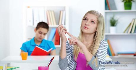 Portrait of pensive teenage blonde counting something at lesson