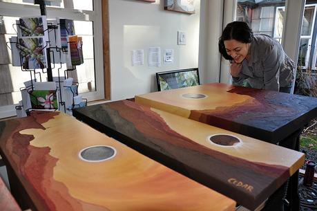 Eclipse paintings in Cedar Lee art studio