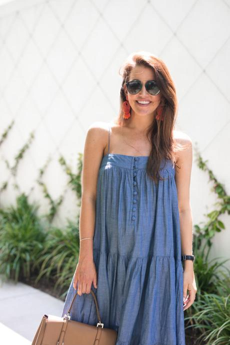 Amy Havins wears a denim tiered maxi dress with flats.
