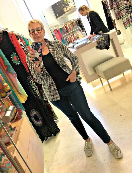 trying on a Missoni jacket