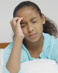 child having migraine