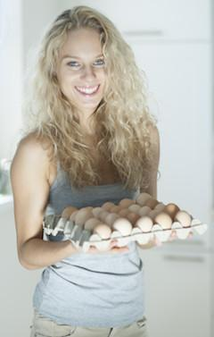 woman carry eggs in kitchen