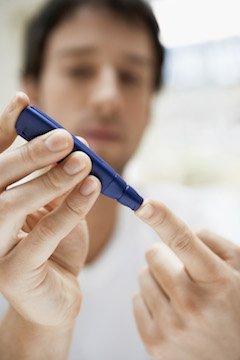 man testing blood sugar levels