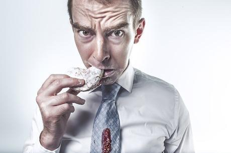 hungry man eating cookie