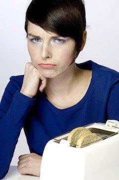 frustrated woman waiting for toast
