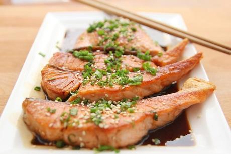 cooked salmon on plate with chopsticks