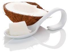 half coconut and spoon of coconut oil