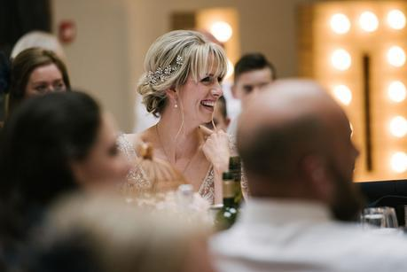bride laughing in the speeches
