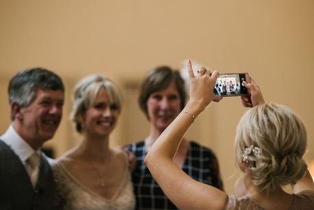 bridesmaid taking a photo on her phone