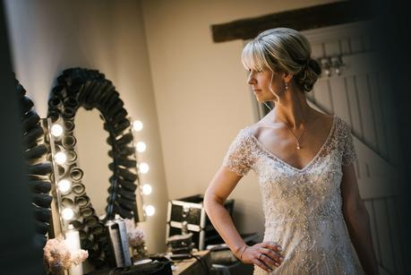 bride posing in front of mirror at blackwell grange