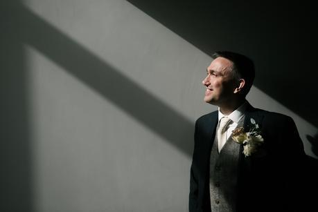 groom looking into the light