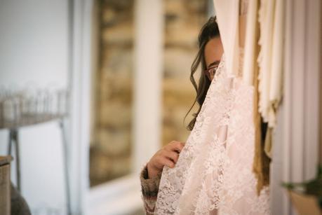 flower girl hiding behind curtain