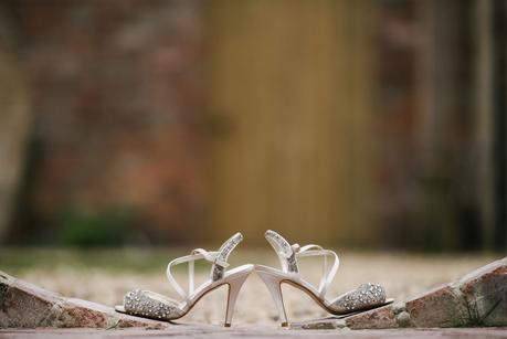 photo of brides shoes on wedding day